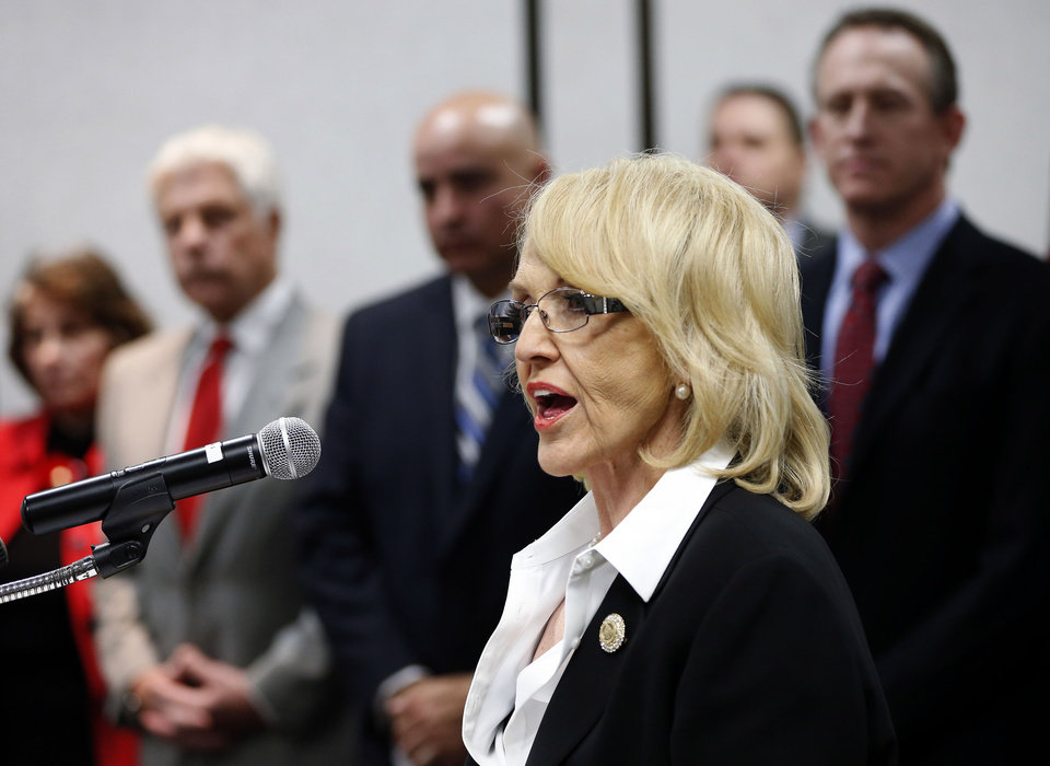 Photo - Arizona Gov. Jan Brewer, R, calls for the expansion of Medicaid, Wednesday, Jan. 26, 2013 in Phoenix with healthcare and business leaders at Maricopa Medical Center. An expansion would call for $8 billion in federal assistance for the State over three years. (AP Photo/Matt York)
