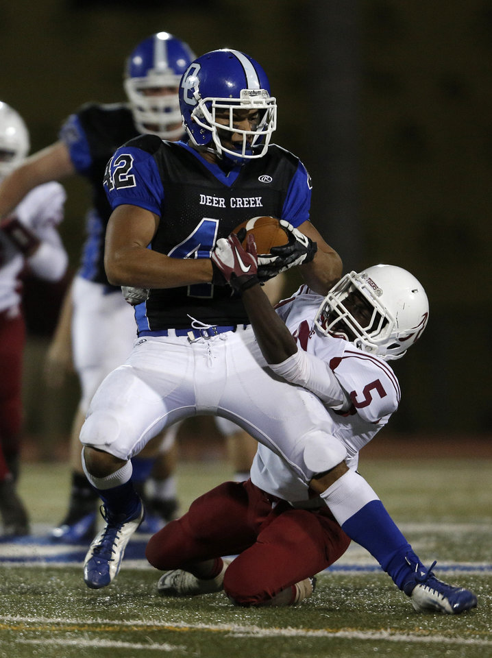 Photo - Deer Creek's Alec James (42) is taken down by Ardmore's Andrew Clark (5) during a high school football game between Deer Creek and Ardmore at Deer Creek Stadium in Edmond, Okla., Friday, Nov. 9, 2012.  Photo by Garett Fisbeck, The Oklahoman