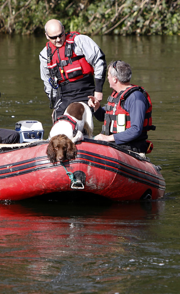 Photo -   A specialist search dog rides on a boat on the River Dyfi as the hunt for missing 5-year old April Jones continues around Machynlleth, mid Wales, Saturday Oct. 6, 2012. The search for April Jones resumed Saturday after bad weather forced searchers to be stood down overnight. The five-year-old girl went missing from near her home in Machynlleth, mid Wales, on Monday evening. (AP Photo / Peter Byrne, PA) UNITED KINGDOM OUT - NO SALES - NO ARCHIVES