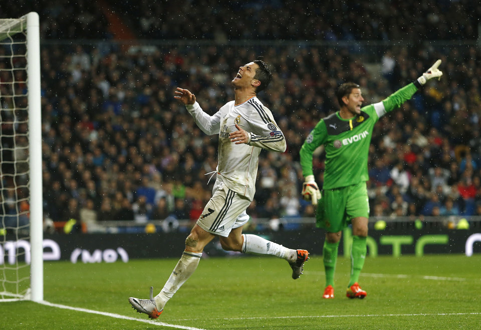Photo - Real's Cristiano Ronaldo reacts after failing to score as Dortmund goalkeeper Roman Weidenfeller, right, argues with his teammates during a Champions League quarterfinal first leg soccer match between Real Madrid and Borussia Dortmund at the Santiago Bernabeu   stadium in Madrid, Spain, Wednesday, April 2, 2014. (AP Photo/Andres Kudacki)