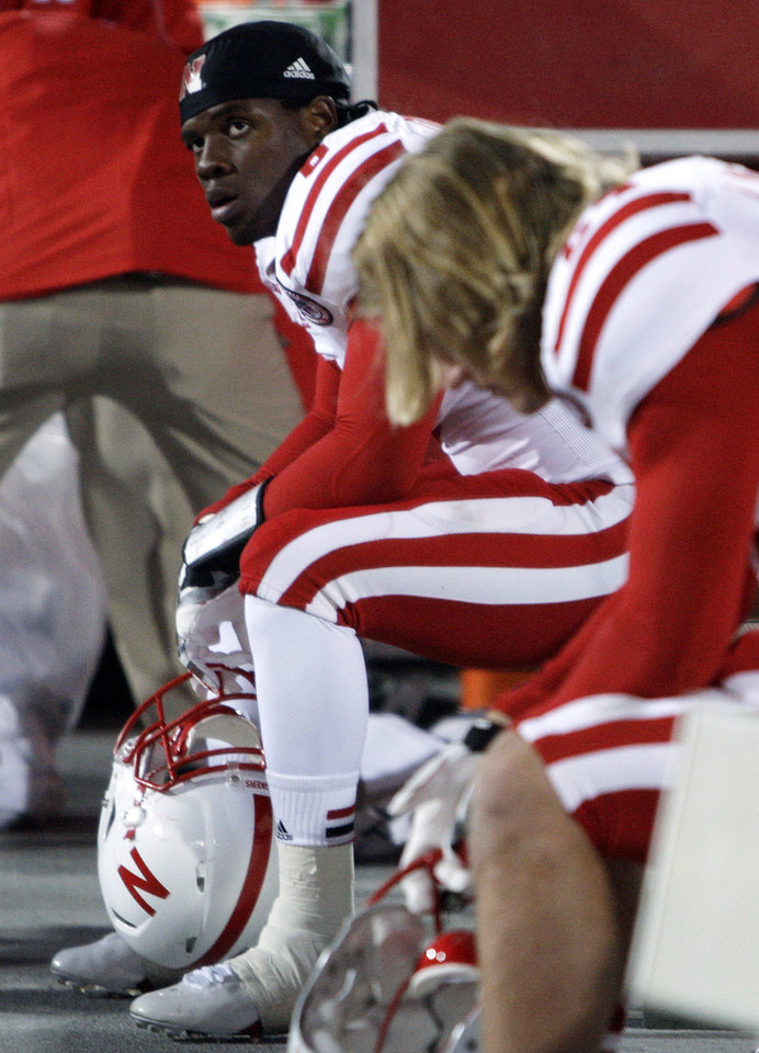 Nebraska's Ameer Abdullah, left, sits on the bench as time runs out in their loss to Ohio State in an NCAA college football game, Saturday, Oct. 6, 2012, in Columbus, Ohio. Ohio State defeated Nebraska 63-38. (AP Photo/Jay LaPrete)