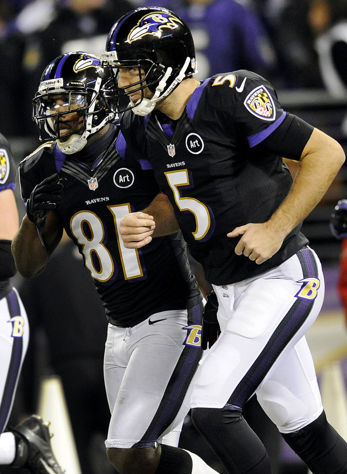 Photo - Baltimore Ravens quarterback Joe Flacco, right, and wide receiver Anquan Boldin runs off the field after Boldin pulled in a pass from Flacco for a touchdown during the first half of an NFL football game against the Pittsburgh Steelers in Baltimore, Sunday, Dec. 2, 2012. (AP Photo/Nick Wass)