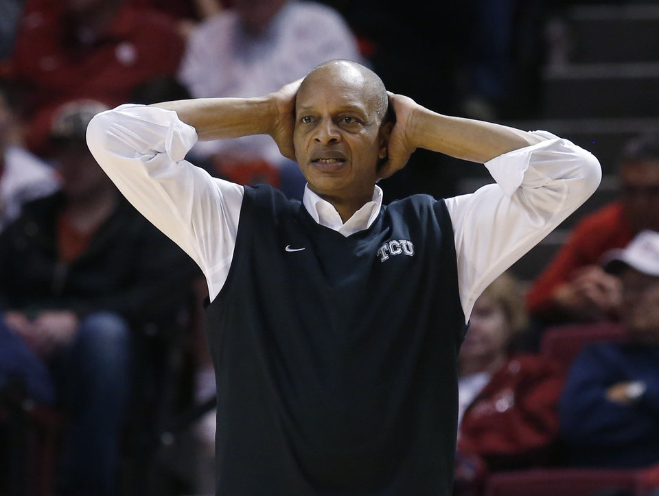 TCU head coach Trent Johnson reacts to a call in the second half of an NCAA college basketball game against Oklahoma in Norman, Okla., Monday, Feb. 11, 2013. Oklahoma won 75-48. (AP Photo/Sue Ogrocki)