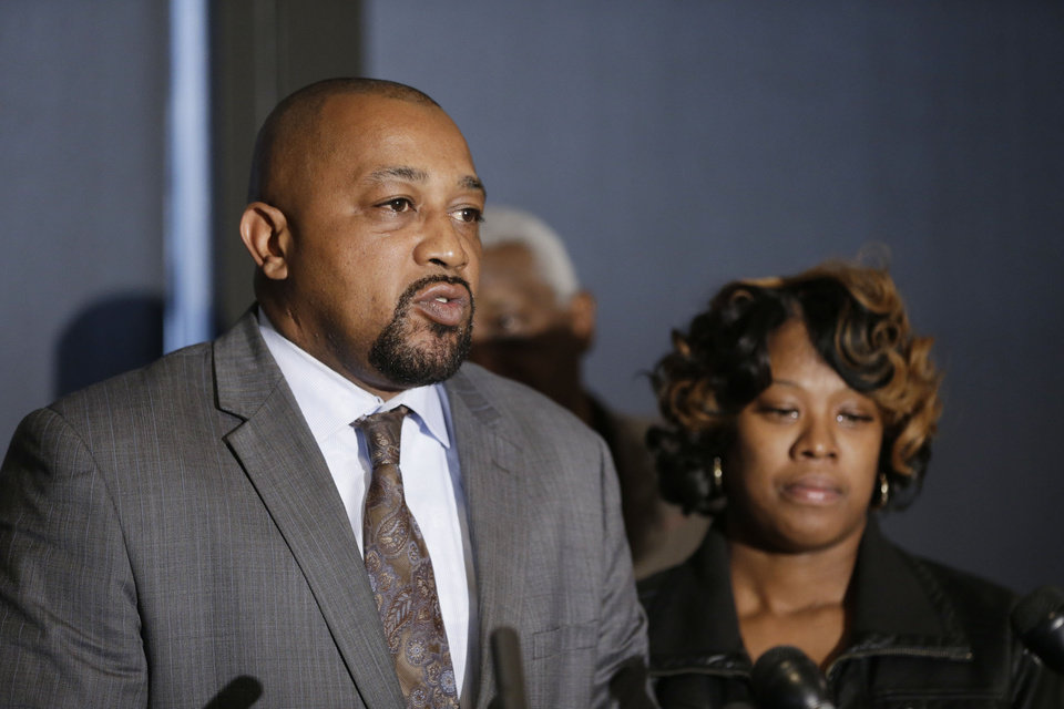 Photo - Walter Ray Simmons and Monica McBride, the parents of Renisha McBride address the media during a news conference in Southfield, Mich., Friday, Nov. 15, 2013. Their daughter was shot on Nov. 2  in the face on Theodore P. Wafer's front porch in Dearborn Heights. (AP Photo/Carlos Osorio)