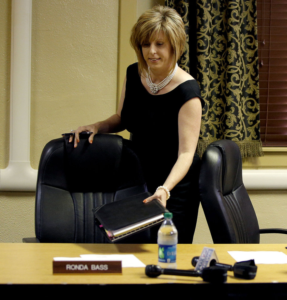 Photo -  Noble Schools Superintendent Ronda Bass takes her seat before a Noble Board of Education meeting to decide her employment status in Noble, Tuesday, Sept. 2, 2014. Bass came under fire for her alleged inappropriate enforcement of the school's dress code. Photo by Bryan Terry, The Oklahoman   Bryan Terry -  THE OKLAHOMAN