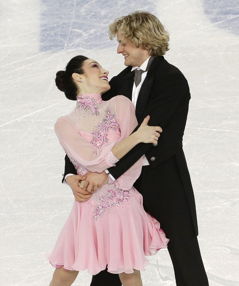 Photo - Meryl Davis and Charlie White of the United States compete in the team ice dance short dance figure skating competition at the Iceberg Skating Palace during the 2014 Winter Olympics, Saturday, Feb. 8, 2014, in Sochi, Russia. (AP Photo/Bernat Armangue)