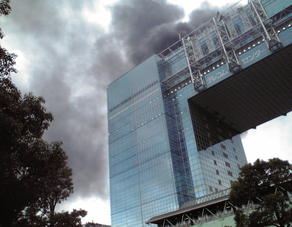 Photo - Black smoke rises from a burning building in Tokyo's Odaiba area in Tokyo Bay area after Japan was struck by a magnitude 8.9 earthquake off its northeastern coast Friday, March 11, 2011. (AP Photo/Kyodo News) JAPAN OUT, MANDATORY CREDIT, FOR COMMERCIAL USE ONLY IN NORTH AMERICA ORG XMIT: TOK809