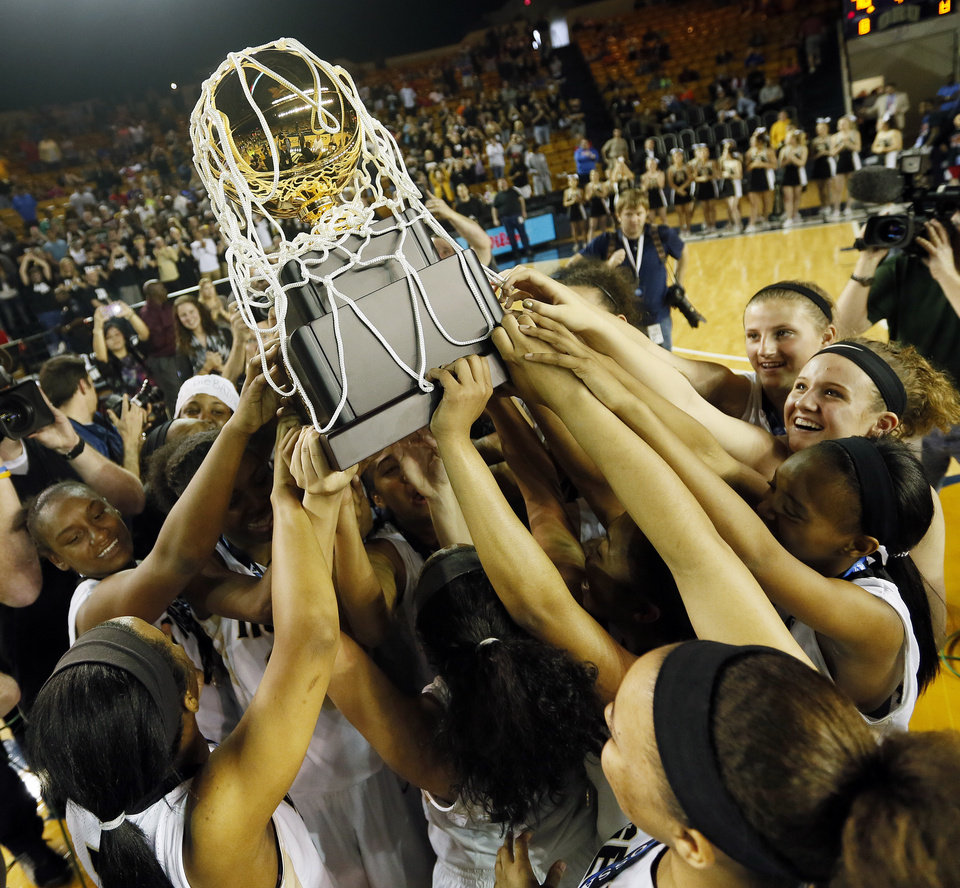 Photo - Broken Arrow celebrates with the gold ball championship trophy after the Class 6A girls championship game in the state high school basketball tournament between Broken Arrow and Edmond Santa Fe at the Mabee Center in Tulsa, Okla., Saturday, March 15, 2014. Broken Arrow won, 70-51. Photo by Nate Billings, The Oklahoman