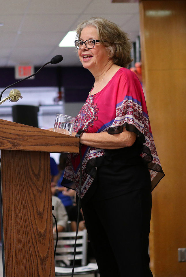 Photo - Mary Best speaks during the AFT education rally at Northwest Classen High School, Saturday, September, 22, 2018.  Photo by Doug Hoke, The Oklahoman