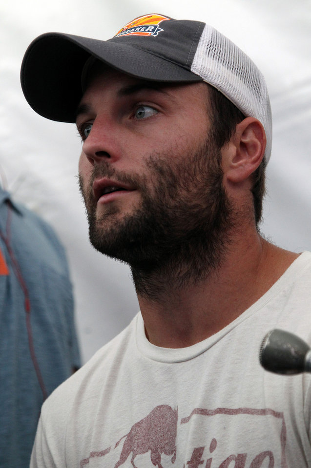 Photo - Denver Broncos wide receiver Wes Welker answers a question during the annual preseason Broncos NFL football training camp, in Englewood, Colo., Wednesday, July 24, 2013. (AP Photo/Brennan Linsley)