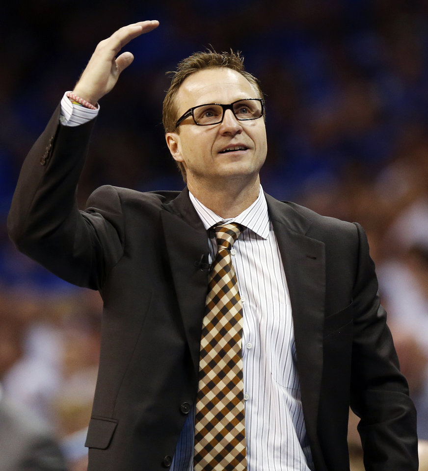 Photo - Oklahoma City head coach Scott Brooks reacts to a call against the Thunder during Game 2 in the first round of the NBA playoffs between the Oklahoma City Thunder and the Memphis Grizzlies at Chesapeake Energy Arena in Oklahoma City, Monday, April 21, 2014. Memphis won 111-105 in overtime. Photo by Nate Billings, The Oklahoman