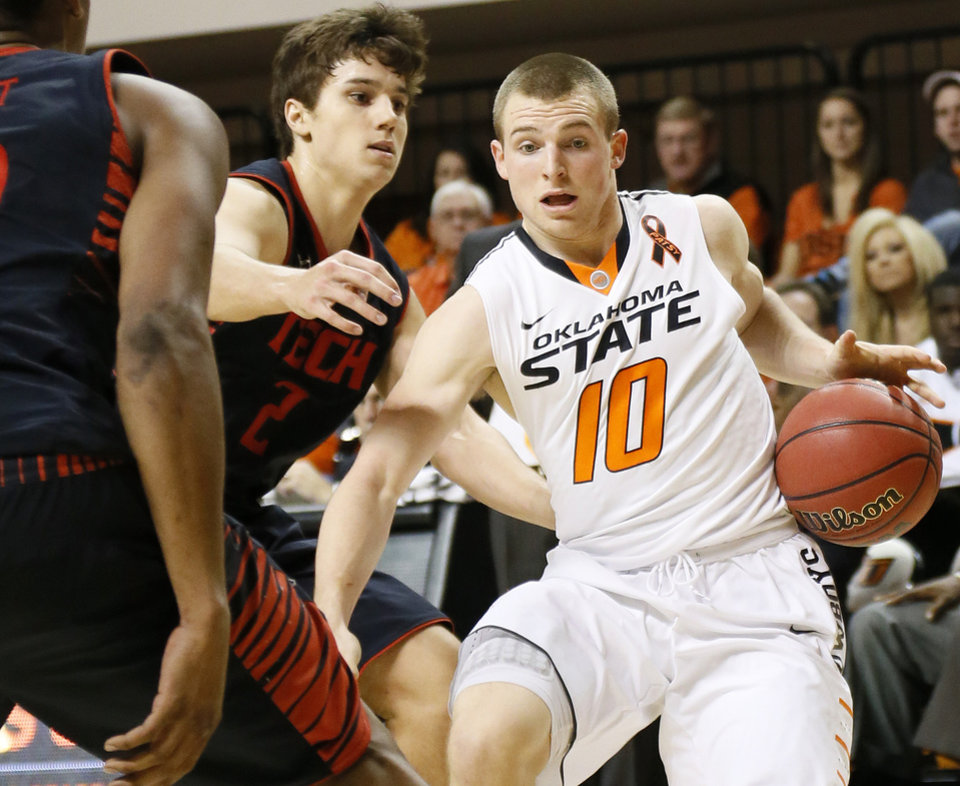 Oklahoma State\'s Phil Forte (10) dribbles away from Texas Tech\'s Dusty Hannahs (2) during a men\'s college basketball game between Oklahoma State University and Texas Tech at Gallagher-Iba Arena in Stillwater, Okla., Saturday, Jan. 19, 2013. OSU won, 79-45. Photo by Nate Billings, The Oklahoman