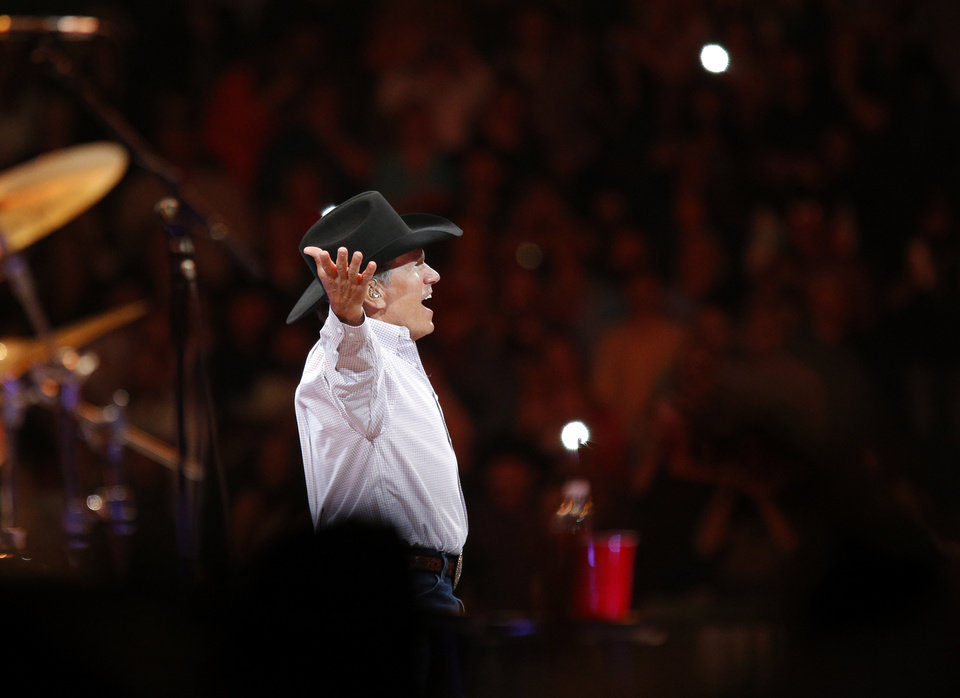 Photo - George Strait acknowledges the crowd as he takes the stage for