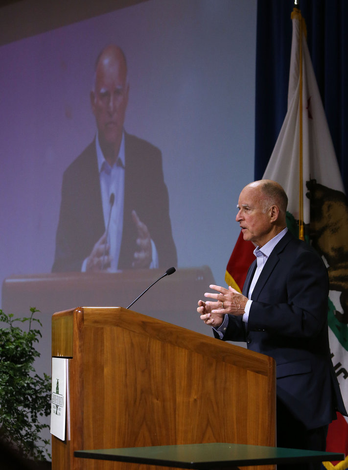 Photo - Gov. Jerry Brown discusses the effects of climate change during his appearance before the University of California  Giannini Foundation of Agricultural Economics conference in  Sacramento, Calif., Monday, May 19, 2014. (AP Photo/Rich Pedroncelli)