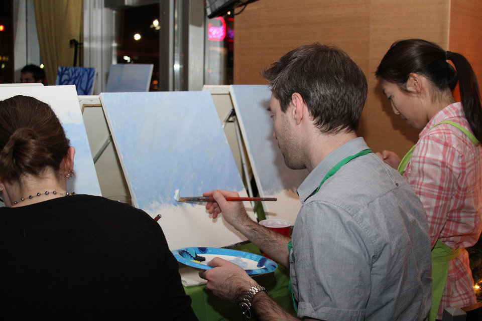 Photo - In this Dec. 4, 2013, photo, provided by Lattice Engines, Lattice Engines's Boston office participates in Paint Nite, in Boston.  Paint Nite is a service event that gives painting lessons at bars and restaurants. About sixty-five people attended.  (AP Photo/ Lattice Engines)