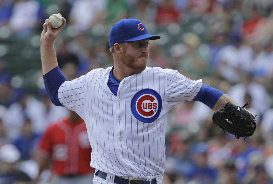 Photo -                    Former Jenks star Dallas Beeler delivers a pitch during his major league debut in June.                     AP Photo