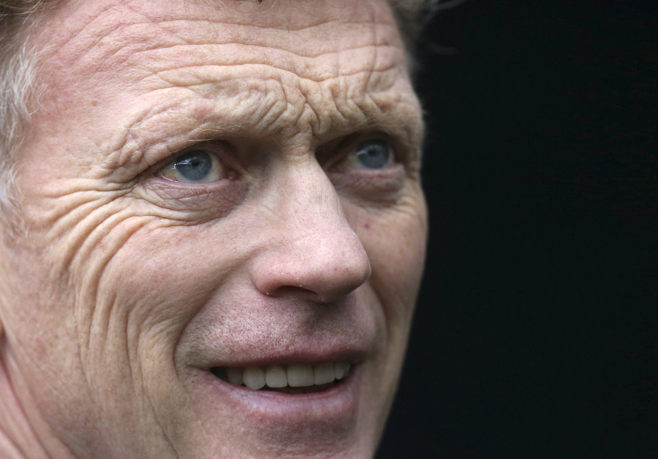 Photo - FILE - In this Saturday, April 5, 2014 file photo Manchester United's manager David Moyes looks on ahead of their English Premier League soccer match against Newcastle United at St James' Park, Newcastle, England. Manchester United says manager David Moyes has left the Premier League club after less than a year in charge, amid heavy speculation he was about to be fired. United released a brief statement in its website Tuesday, saying the club