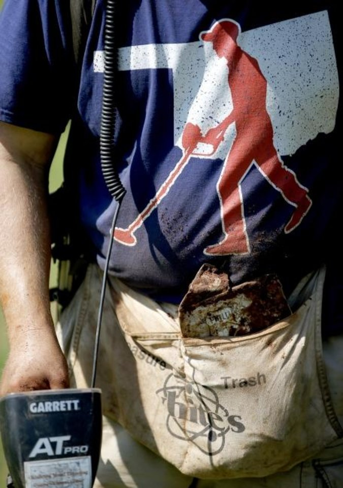 Photo -  Justin Finley, of Oklahoma City,wears a pouch separated in two pockets, marked