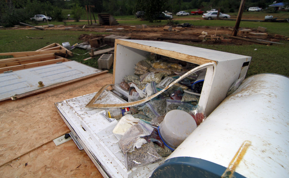 Photo - A freezer full of food sits outside the remains of a trailer in Preston, Miss., following a tornado touchdown Wednesday, April 27, 2011, that resulted in the deaths of three related women.   (AP Photo/Rogelio V. Solis)