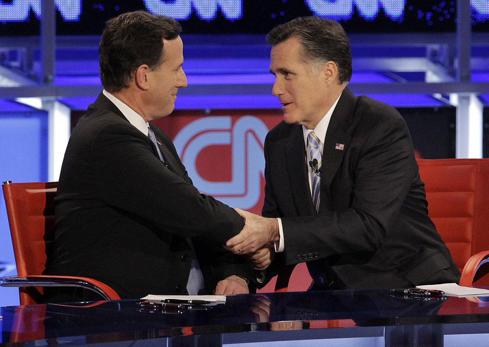 Photo -   FILE - In this Feb. 22, 2012, file photo Republican presidential candidate and former Massachusetts Gov. Mitt Romney, right, talks with fellow candidate, former Pennsylvania Sen. Rick Santorum, left, after a presidential debate in Arizona. Romney on Friday met privately with Santorum, who has indicated he will ultimately endorse Romney. Since the day Santorum left the race, Romney's campaign has been recruiting former Santorum staffers and courting his key allies, including his donors. (AP Photo/Jae C. Hong, File)