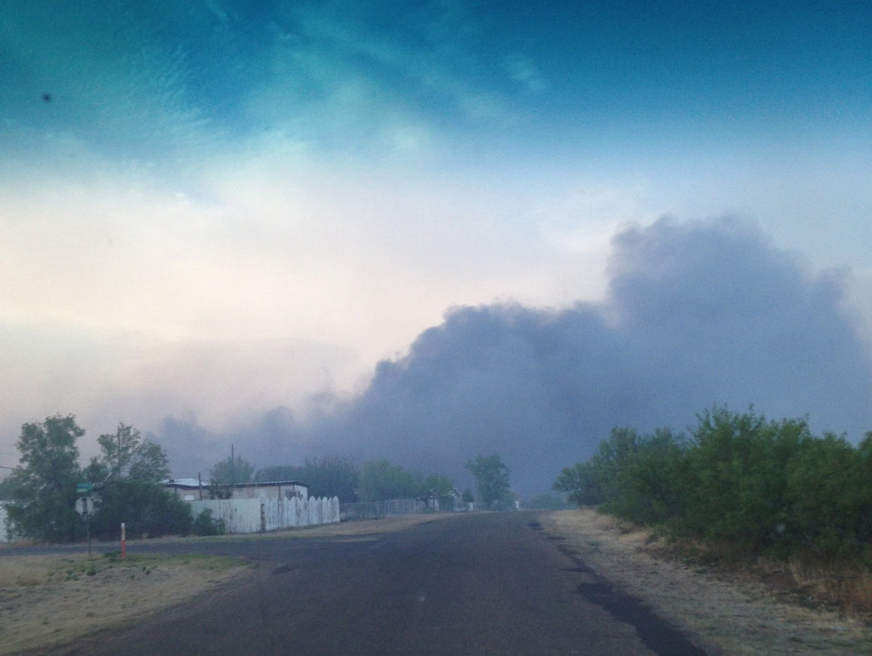Photo - In this Sunday, May 11, 2014 photo provided by the Texas Department of Public Safety, a wildfire burns near Fritch, Texas. The wildfire has led to evacuations and road closures and has destroyed dozens of homes. (AP Photo/Texas Department of Public Safety, Chris Ray)