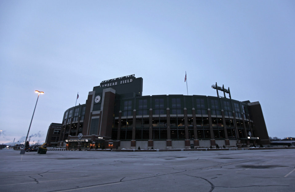 Photo - Lambeau Field awaits an NFL wild-card playoff football game between the Green Bay Packers and the San Francisco 49ers, Sunday, Jan. 5, 2014, in Green Bay. (AP Photo/Kiichiro Sato)