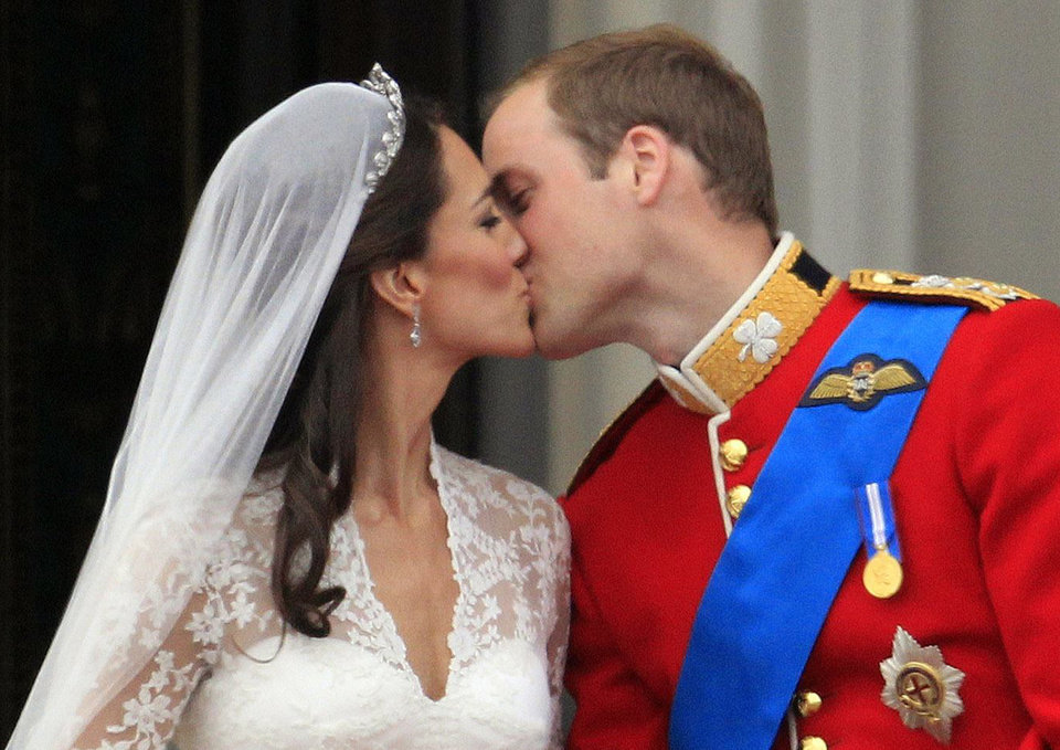 Photo - Britain's Prince William kisses his wife Kate, Duchess of Cambridge, on the balcony of Buckingham Palace after the Royal Wedding in London Friday, April, 29, 2011. (AP Photo/Matt Dunham) ORG XMIT: RWMG178