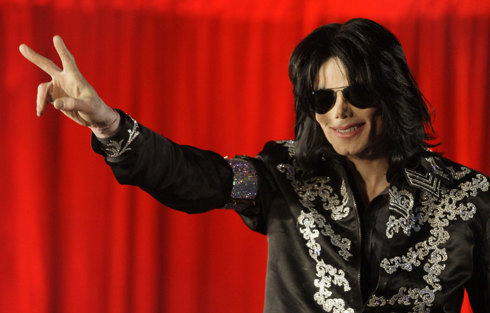 "Photo - FILE - In this March 5, 2009 file photo US singer Michael Jackson announces that he is set to play ten live concerts at the London O2 Arena in July, which he announced at a press conference at the London O2 Arena. Jackson's death on June 25, 2009 stunned the world, and sparked nostalgia for the singer's music that have transformed his image and catapulted his estate to the top of earnings charts. Jackson's death returned him to the top of the record charts and quickly generated hundreds of millions of dollars through deals for new albums and a movie created from his final rehearsals for his planned ""This Is It"" comeback concerts. (AP Photo/Joel Ryan, File)"