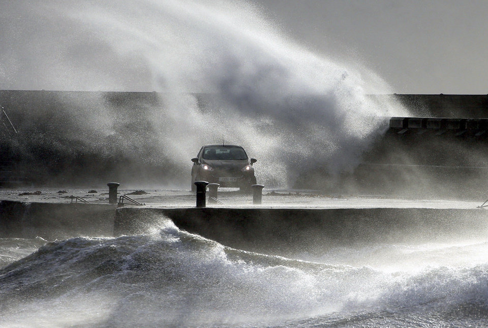 Photo -  Waves lash the coast on the Ayrshire coast at Ardrossan, Scotland, Sunday, Feb. 9, 2020. Trains, flights and ferries have been cancelled and weather warnings issued across the United Kingdom and in northern Europe as the storm with winds expected to reach hurricane levels batters the region. (Andrew Milligan/PA via AP)