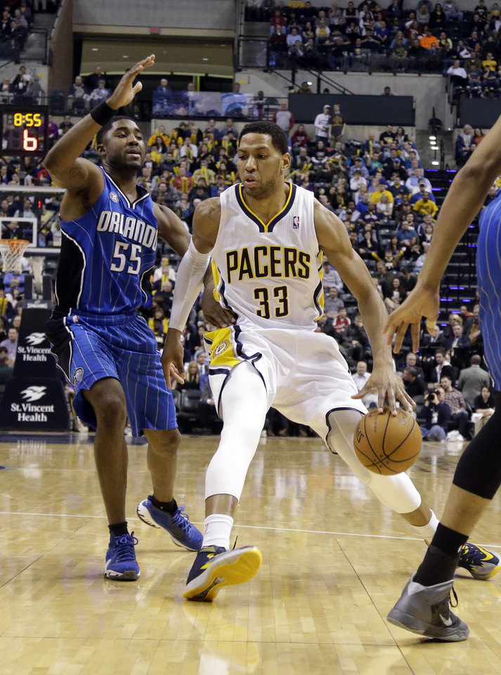 Photo - Indiana Pacers forward Danny Granger (33) drives in front of Orlando Magic guard E'Twaun Moore in the second half of an NBA basketball game in Indianapolis, Monday, Feb. 3, 2014. The Pacers defeated the Magic 98-79. (AP Photo/Michael Conroy)