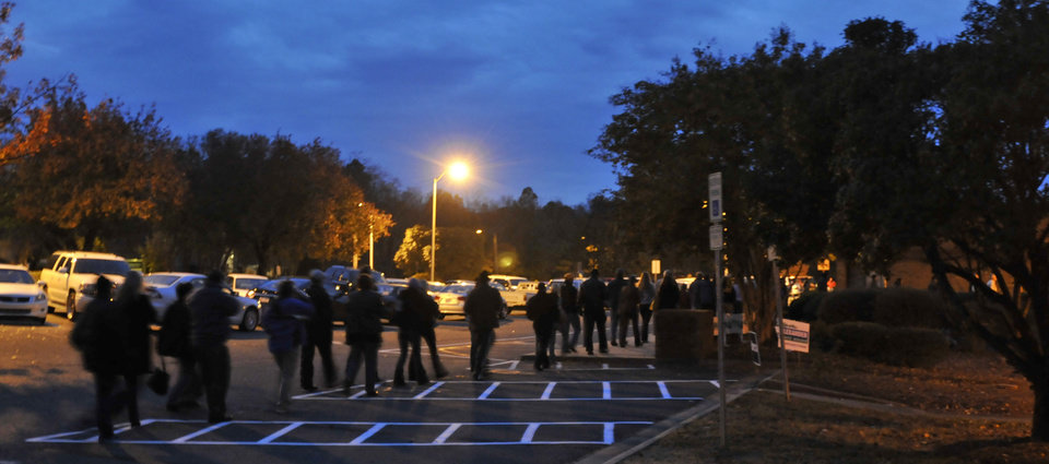Early voters line up outside McAlpine Elementary School to vote on Election Day, Tuesday, Nov. 6, 2012 in Charlotte, N.C. (AP Photo/The Charlotte Observer, Davie Hinshaw) LOCAL TV OUT (WSOC, WBTV, WCNC, WCCB); LOCAL PRINT OUT (CHARLOTTE BUSINESS JOURNAL, CREATIVE LOAFLING, CHARLOTTE WEEKLY, MECHLENBURG TIMES, CHARLOTTE MAGAZINE, CHARLOTTE PARENTS) LOCAL RADIO OUT (WBT)