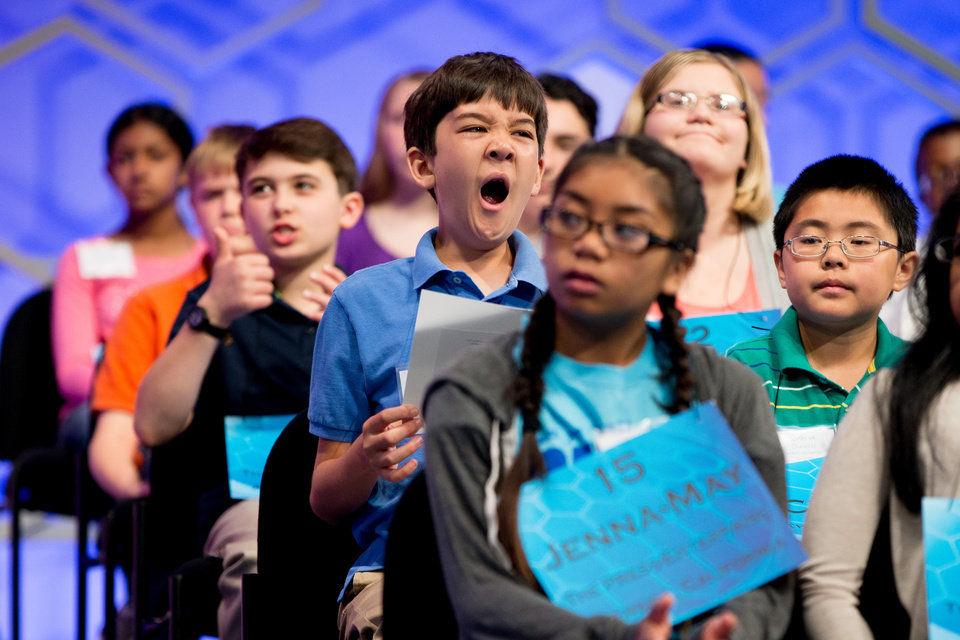 Photo - Tyler Berndt, 12, of West Palm Beach, Fla. yawns during the 2015 Scripps National Spelling Bee, Wednesday, May 27, 2015, in Oxon Hill, Md. (AP Photo/Andrew Harnik)