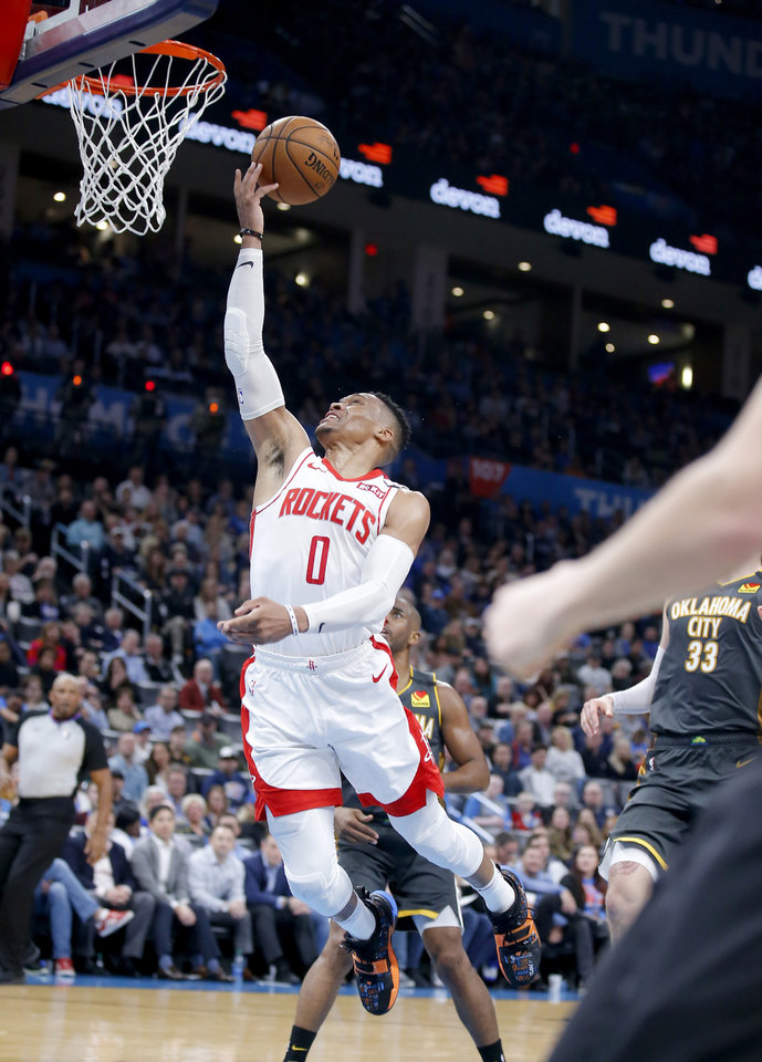 Photo - Houston's Russell Westbrook (0) goes up for a lay up during the NBA basketball game between the Oklahoma City Thunder and the Houston Rockets at the Chesapeake Energy Arena in Oklahoma City,  Thursday, Jan. 9, 2020.  [Sarah Phipps/The Oklahoman]