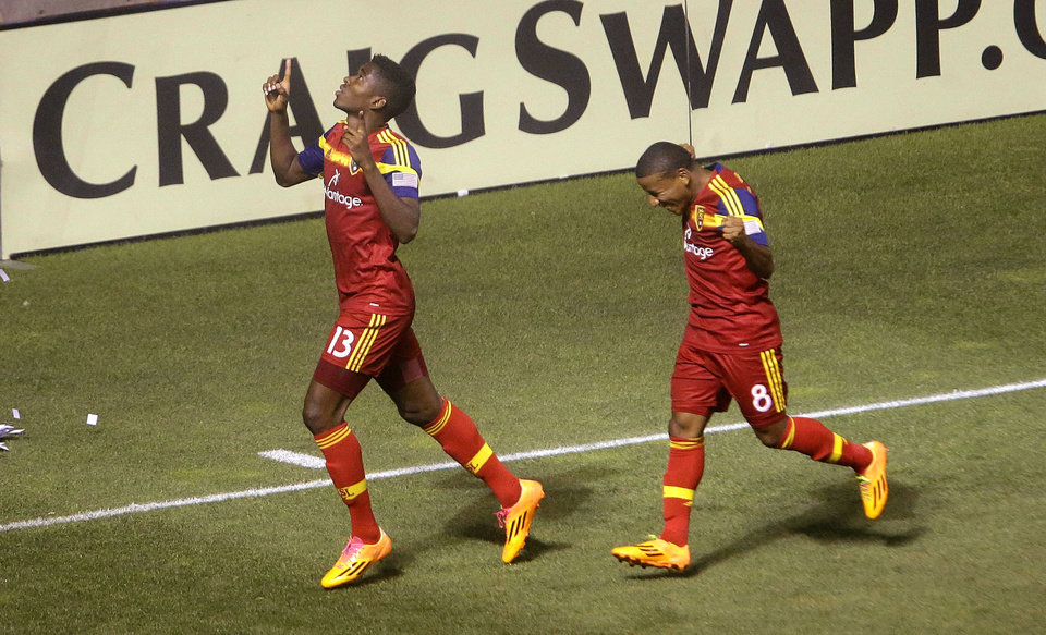 Photo - Real Salt Lake's Olmes Garcia (13) celebrates with Joao Plata (8) after scoring against the Montreal Impact during an MLS soccer game Thursday, July 24, 2014, in Sandy, Utah. (AP Photo/Rick Bowmer)