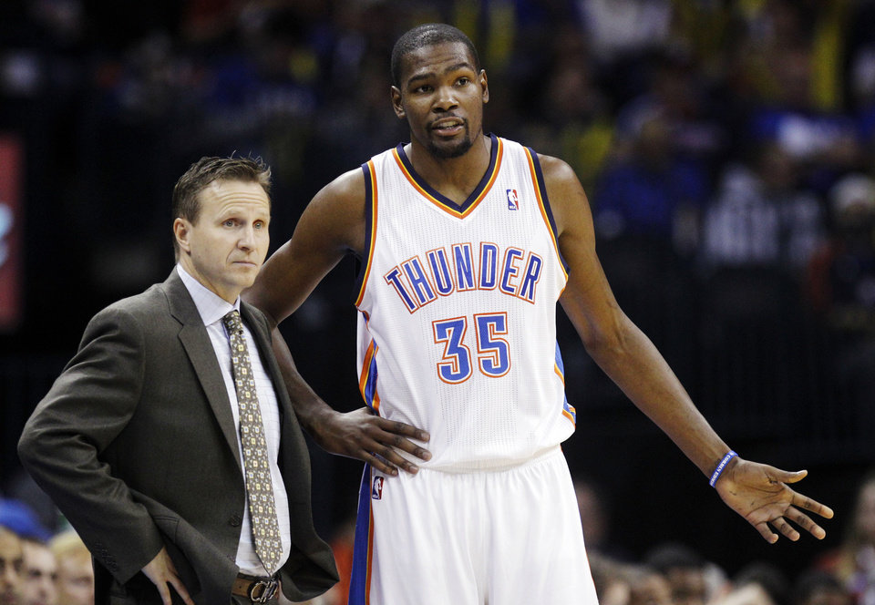 Oklahoma City Thunder head coach Scott Brooks talks with forward Kevin Durant (35) during the third quarter of an NBA basketball game against the Golden State Warriors in Oklahoma City, Sunday, Nov. 18, 2012. Oklahoma City won 119-109. (AP Photo/Sue Ogrocki)