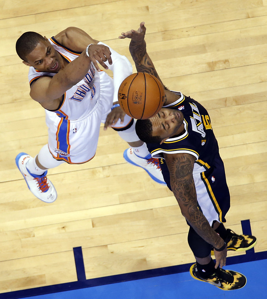 Oklahoma City Thunder\'s Russell Westbrook (0) shoots over Utah Jazz\'s Mo Williams (5) during the NBA basketball game between the Oklahoma City Thunder and the Utah Jazz at Chesapeake Energy Arena on Wednesday, March 13, 2013, in Oklahoma City, Okla. Photo by Chris Landsberger, The Oklahoman