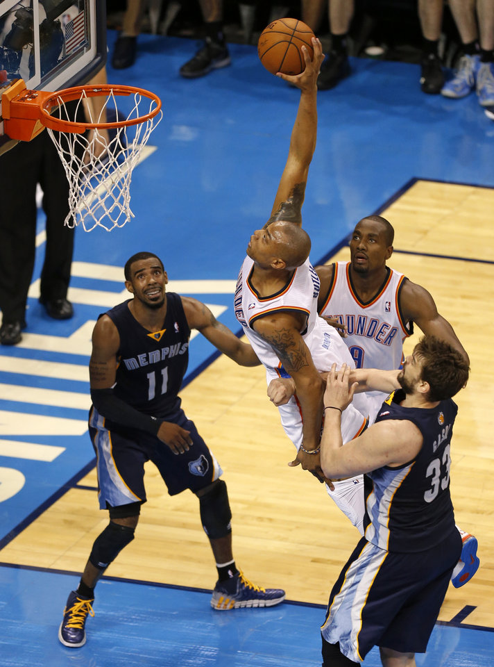 Photo - Oklahoma City's Caron Butler (2) goes by Memphis' Marc Gasol (33) for a dunk as Mike Conley (11) and Oklahoma City's Serge Ibaka (9) watch during Game 1 in the first round of the NBA playoffs between the Oklahoma City Thunder and the Memphis Grizzlies at Chesapeake Energy Arena in Oklahoma City, Saturday, April 19, 2014. PHOTO BY NATE BILLINGS, The Oklahoman