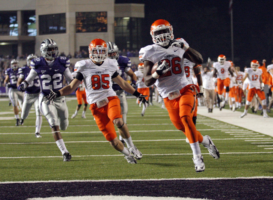 Oklahoma State\'s Desmond Roland (26) scores a touchdown on a kickoff return during the college football game between Kansas State University (KSU) and Oklahoma State (OSU) at Bill Snyder Family Football Stadium in Manhattan, Kan., Saturday, Nov. 3, 2012. Photo by Sarah Phipps, The Oklahoman
