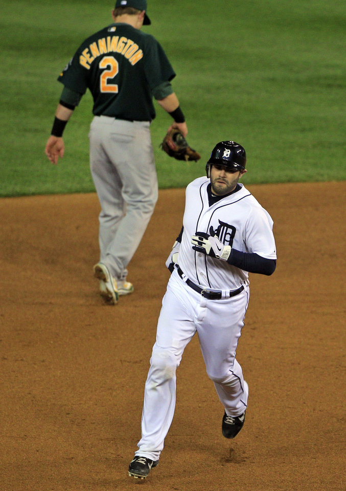 Photo -   Detroit Tigers' Alex Avila rounds second base after hitting a solo home run during the fifth inning of Game 1 of the American League division baseball series against the Oakland Athletics, Saturday, Oct. 6, 2012, in Detroit. (AP Photo/Carlos Osorio)