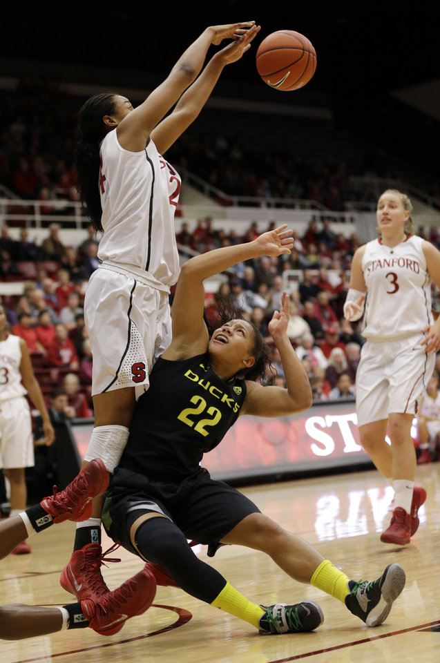 Photo - Oregon's Ariel Thomas (22) has her shot blocked by Stanford forward Erica McCall, left, during the first half of an NCAA college basketball game on Friday, Jan. 3, 2014, in Stanford, Calif. (AP Photo/Marcio Jose Sanchez)