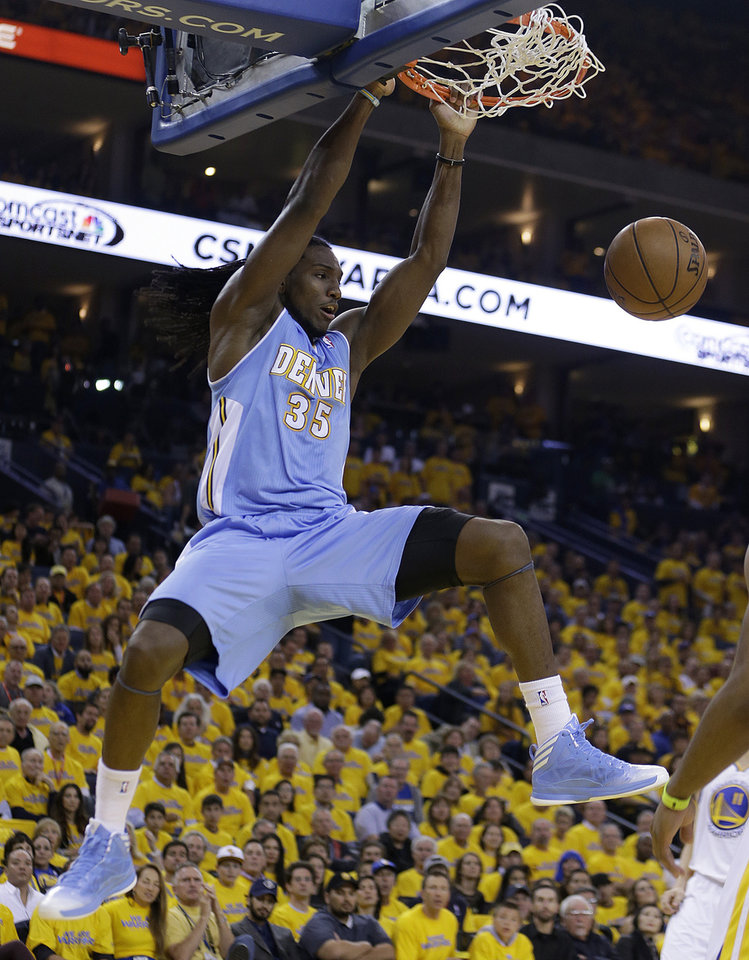 Denver Nuggets\' Kenneth Faried (35) scores against the Golden State Warriors during the first half of Game 3 in a first-round NBA basketball playoff series on Friday, April 26, 2013, in Oakland, Calif. (AP Photo/Ben Margot)