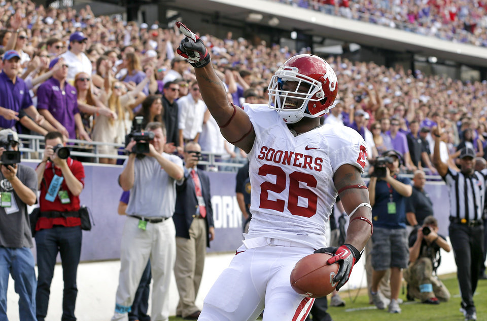 Oklahoma's Damien Williams (26) celebrates after a touchdown during a college football game between the University of Oklahoma Sooners (OU) and the Texas Christian University Horned Frogs (TCU) at Amon G. Carter Stadium in Fort Worth, Texas, Saturday, Dec. 1, 2012. Photo by Bryan Terry, The Oklahoman