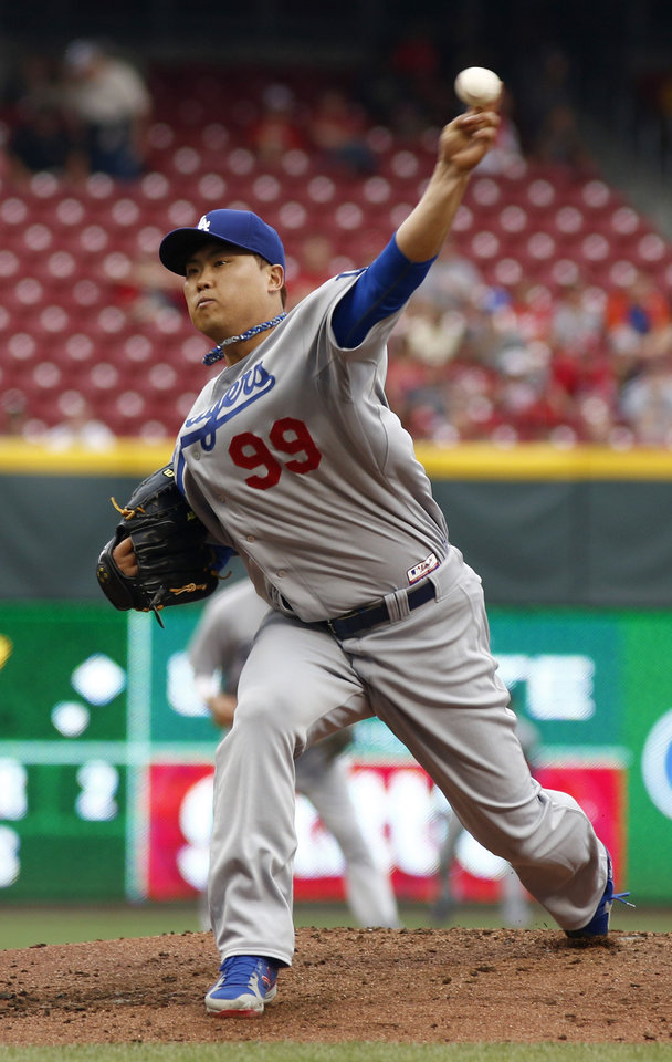Photo - Los Angeles Dodgers starting pitcher Hyun-Jin Ryu throws against the Cincinnati Reds during the first inning of a baseball game, Wednesday, June 11, 2014, in Cincinnati. (AP Photo/David Kohl)