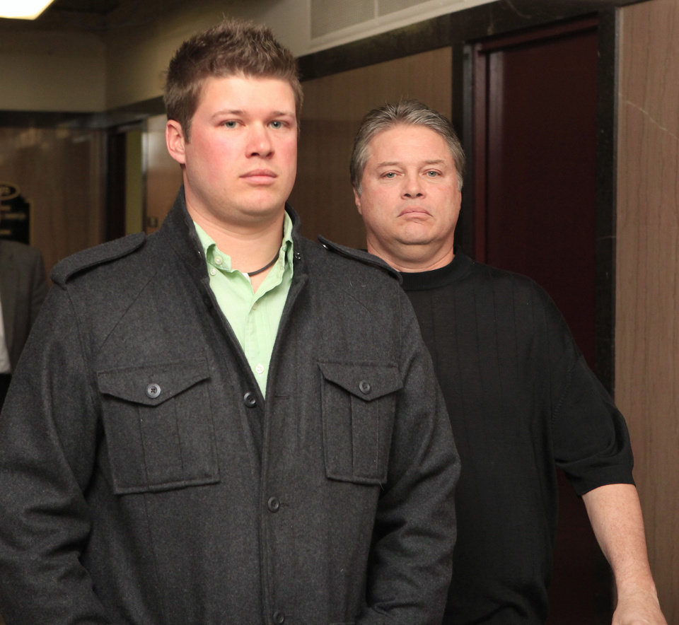 Photo - Daniel Mitchell, left, and his father Teddy Mitchell both testified before a state grand jury on March 29, 2011.   PAUL B. SOUTHERLAND - PAUL B. SOUTHERLAND