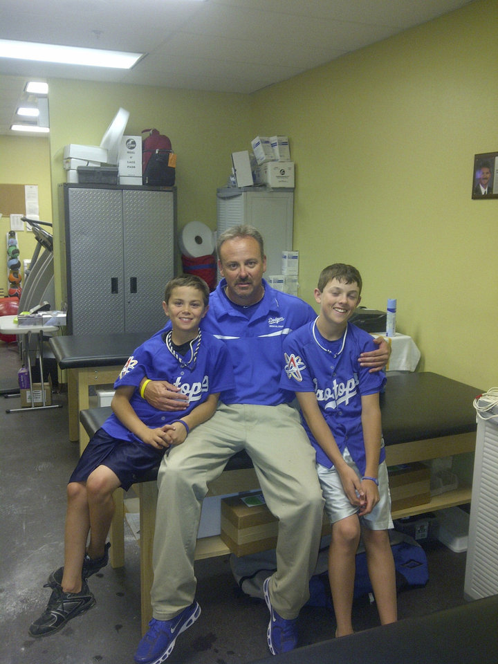 Son Joshua Harrel, photo from left, father Greg Harrel and son Ryan Harrel, are shown here on Father\'s Day 2011 in the trainer\'s room for the Albuquerque (N.M.) Isotopes. The Harrels live in Cashion and Greg Harrel, during the 2012 Major League Baseball season, will serve as the assistant athletic trainer for the Los Angeles Dodgers. Provided photo - Provided photo