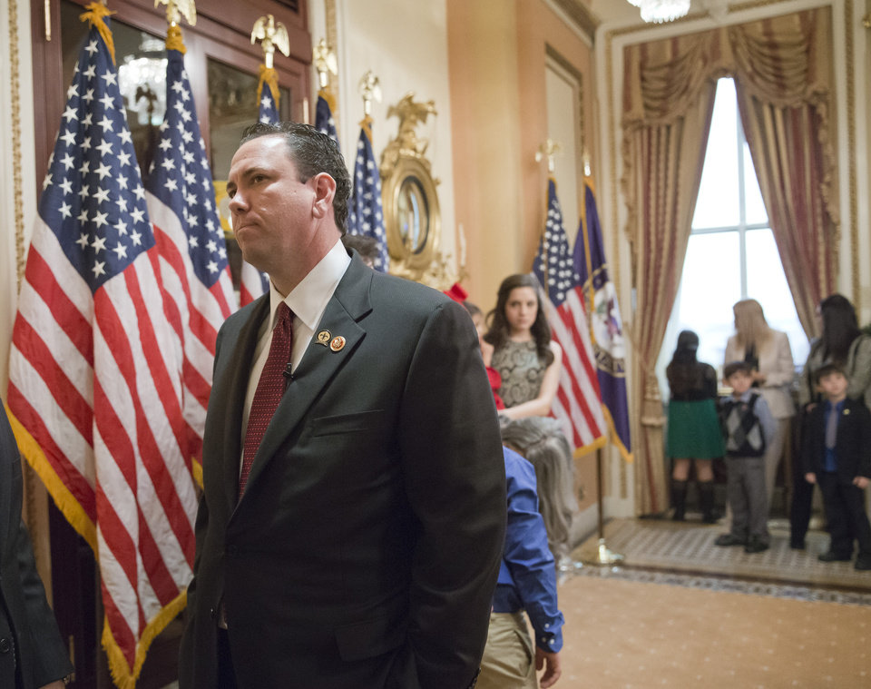 Photo - This photo taken Nov. 21, 2013 shows then-newly-elected Rep. Vance McAllister, R-La. waiting to be sworn in on Capitol Hill in Washington. McAllister says he's asking his family and constituents for forgiveness after a West Monroe newspaper published a video that it says shows the congressman kissing a female staffer in his congressional office in Monroe, La. McAllister, only in office a little over four months, attracted national attention because of his endorsement from the bearded men of the
