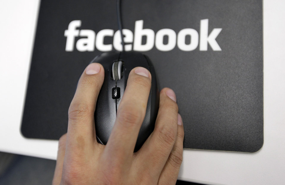 A Facebook User Operations Safety Team worker looks at reviews at Facebook headquarters in Menlo Park, Calif. AP Photo