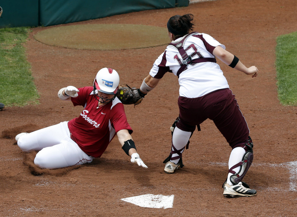 Sooner pitcher Keilani Ricketts is tagged out at home by Meagan May at the NCAA Super Regional softball game as the University of Oklahoma (OU) Sooners defeat Texas A&M 8-0 at Marita Hines Field on Saturday, May 25, 2013 in Norman, Okla. to advance to the College World Series. Photo by Steve Sisney, The Oklahoman