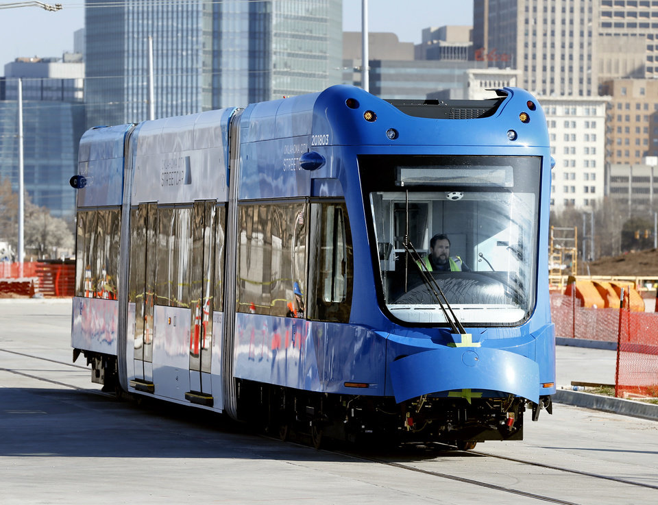 Photo -  Oklahoma City's third streetcar, in the Clear Sky Blue color scheme, was delivered in early March. Streetcar system testing has begun and will continue through November. Service begins in December. [Photo by Steve Sisney, The Oklahoman]