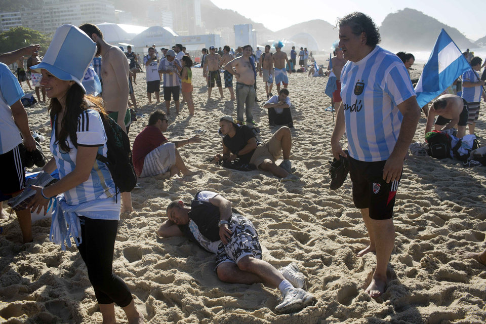Photo - Argentina soccer fans gather after spending the night on Copacabana Beach in Rio de Janeiro, Brazil, Sunday, July 13, 2014. Argentina will face Germany in the World Cup final today Sunday July 13. (AP Photo/Rodrigo Abd)